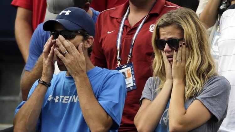 Andy Roddick's wife, Brooklyn Decker, right, reacts after his fourth round loss to Argentina's Juan Martin Del Potro at the  2012 US Open tennis tournament, Wednesday, Sept. 5, 2012, in New York. Roddick said he would retire after the match. (AP Photo/Charles Krupa)