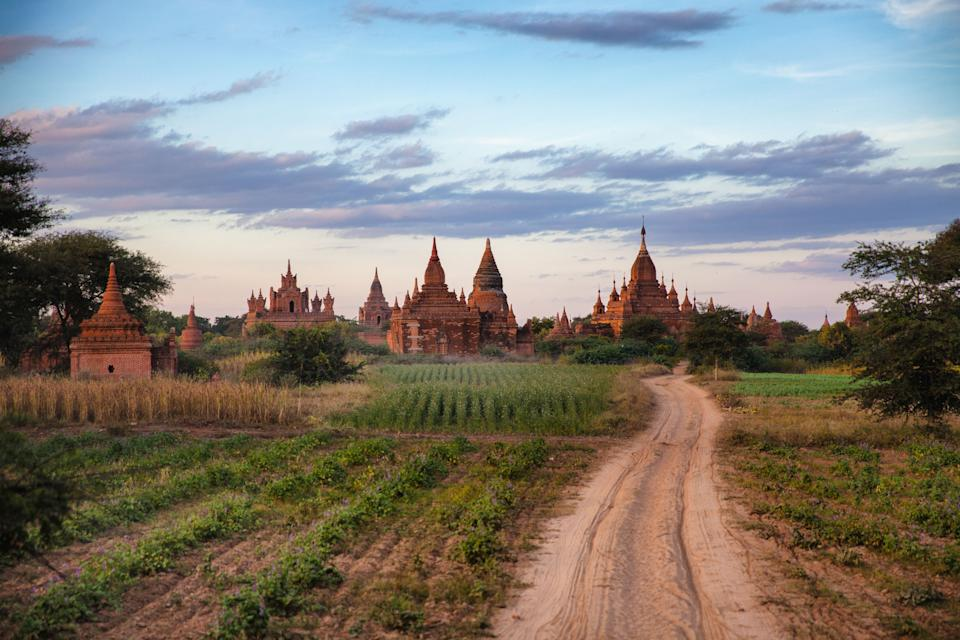 In this December 2012 photo the sun sets over some of the over Pagodas in Bagan, Myanmar. (AP Photo/Richard Camp)