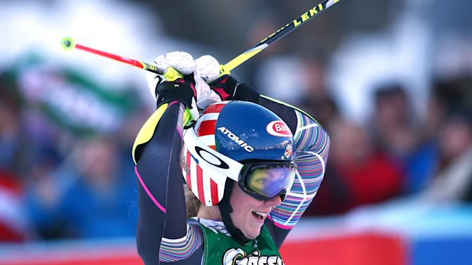 Mikaela Shiffrin of the United States celebrates her third place in an alpine ski, women's World Cup giant slalom, in Lienz, Austria, Saturday, Dec. 28, 2013. (AP Photo/Giovanni Auletta)