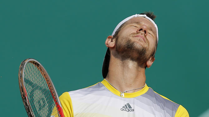 Austria's Jurgen Melzer reacts during his match of the Monte Carlo Tennis Masters tournament in Monaco against France's Jo-Wilfried Tsonga, Thursday, April 18, 2013. (AP Photo/Lionel Cironneau)
