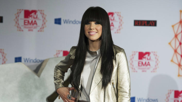 Canadian singer  Carly Rae Jepsen poses during a photo call at the Frankfurt town hall, in Frankfurt Germany Saturday, Nov. 10, 2012. She is one of the nominees for Sunday's MTV European Music Awards 2012 celebrated in Frankfurt. (AP Photo/dapd/Thomas Lohnes)