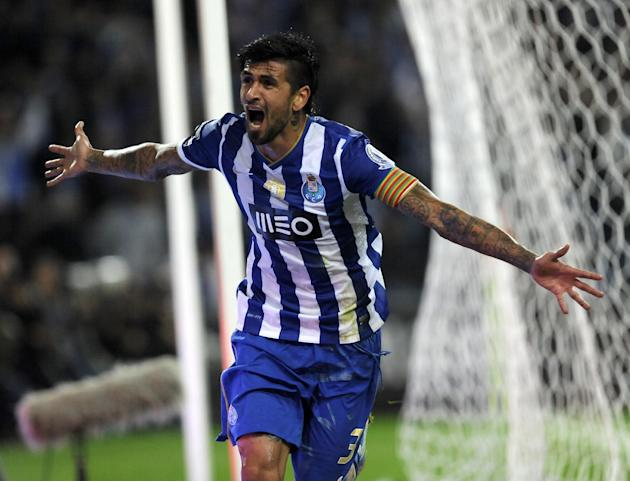 FC Porto's Lucho Gonzalez, from Argentina, celebrates after scoring his side's third goal against Sporting in a Portuguese League soccer match at the Dragao stadium in Porto, Portugal, Sunday, Oct. 27