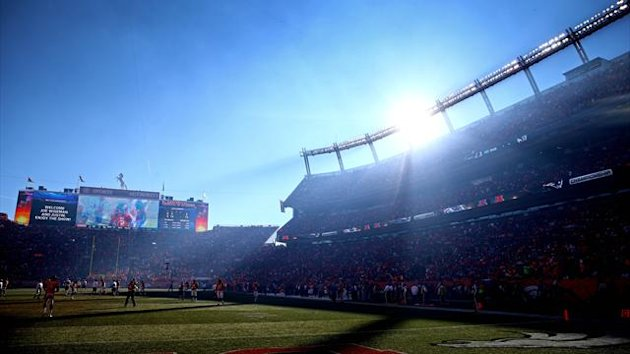 The sun sets behind Sports Authority Field at Mile High at the start of the third quarter between the New England Patriots against the Denver Broncos in the 2013 AFC Championship football game (Reuters)