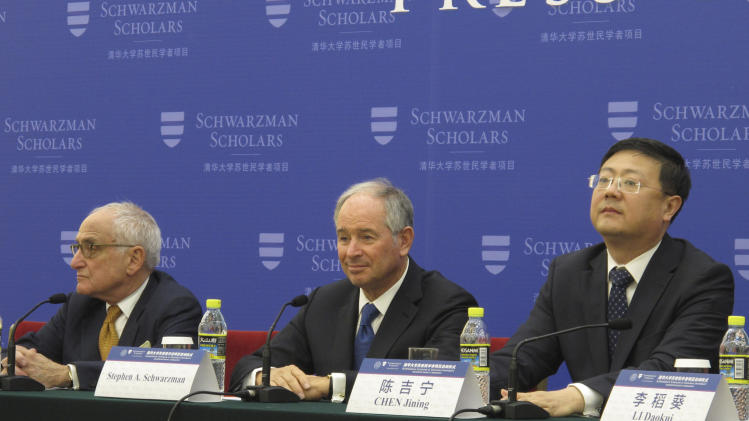 Stephen A. Schwarzman, center, founder of the U.S. private equity firm Blackstone, attends a press conference at the Great Hall of People in Beijing, China Sunday, April 21, 2013. Schwarzman announced Sunday the establishment of a $300 million endowed scholarship program in China for students from around the world, and billed it as a rival to the prestigious Rhodes Scholarship. Schwarzman said he would give $100 million as a personal gift and raise another $200 million to endow the Schwarzman Scholars program at Beijing's Tsinghua University. It will be the largest philanthropic gift with foreign money in China's history, according to the tycoon and the university. Sitting on the right is Chen Jining, president of Tsinghua University and on the left is Robert A. M. Stern, dean of the Yale School of Architecture. (AP Photo/Didi Tang)