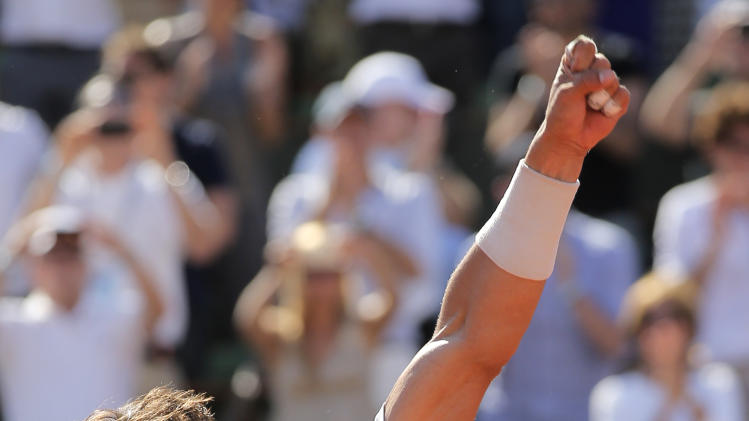 Spain's Rafael Nadal reacts after defeating Serbia's Novak Djokovic during their semifinal match of the French Open tennis tournament at the Roland Garros stadium Friday, June 7, 2013 in Paris. (AP Photo/Christophe Ena)