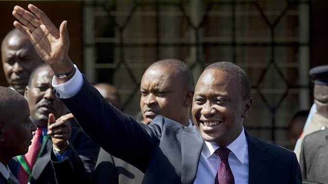 Kenya's President-Elect Uhuru Kenyatta waves to supporters after leaving the National Election Center where final election results were announced declaring he would be the country's next president, in Nairobi, Kenya, Saturday, March 9, 2013. (AP Photo/Ben Curtis)