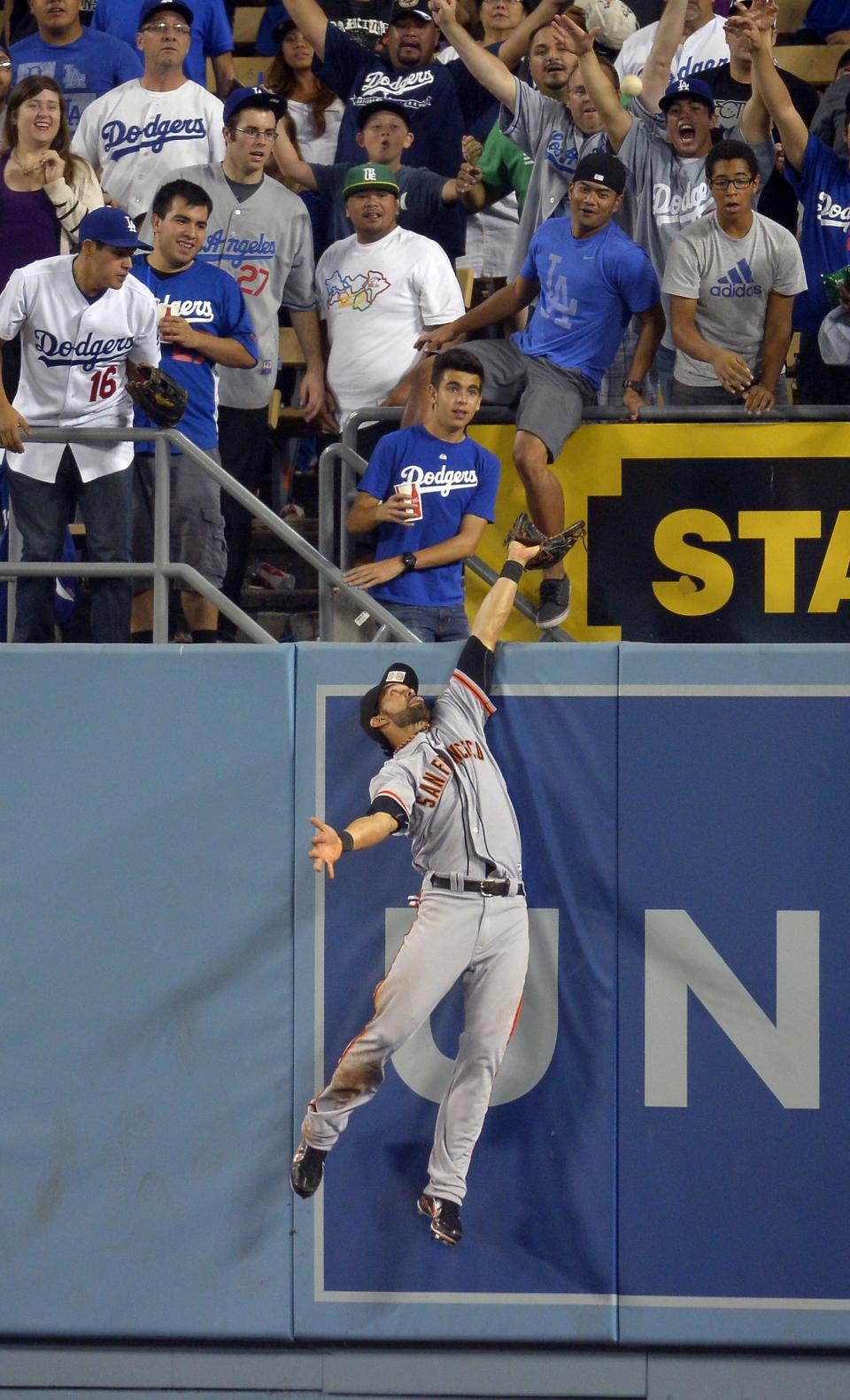 San Francisco Giants center fielder Angel Pagan can't reach a ball hit for a two-run home run by Los Angeles Dodgers' A.J. Ellis during the seventh inning of their baseball game, Tuesday, Oct. 2, 2012, in Los Angeles. (AP Photo/Mark J. Terrill)