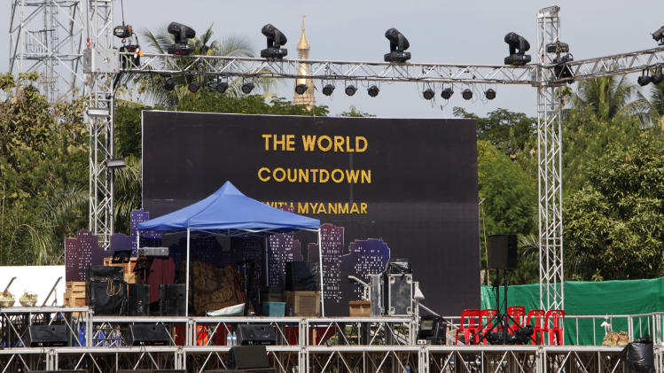 Preparations are underway for the country's first ever public New Year's countdown celebration, at Myoma grounds in Yangon, Myanmar, Monday, Dec. 31, 2012. Myanmar will ring in the new year with its first public countdown and a grand fireworks display Monday night in a celebration unprecedented in the former military-ruled country. (AP Photo/Khin Maung Win)