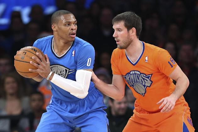 Oklahoma City Thunder point guard Russell Westbrook (0) looks to pass around New York Knicks point guard Beno Udrih (18) during the first half of an NBA basketball game at Madison Square Garden, Wedne