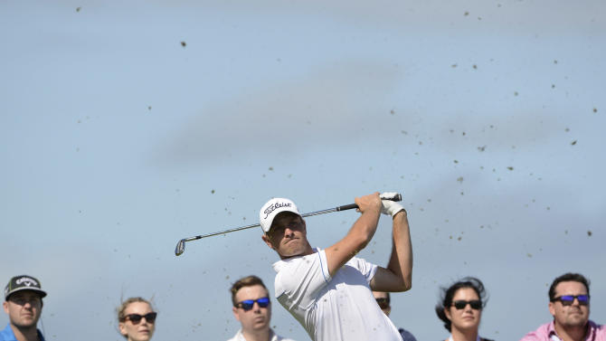 Jake Higginbottom of Australia hits a shot on day three of the Fiji International golf tournament at the Natadola Bay Championship golf course in Nadi, on August 16, 2014