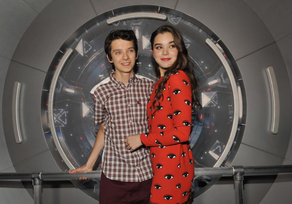 "Asa Butterfield, left, and Hailee Steinfeld, cast members in the forthcoming film ""Ender's Game,"" pose together at a preview event for the film at the 2013 Comic-Con International Convention on Wednesday, July 17, 2013 in San Diego, Calif. (Photo by Chris Pizzello/Invision/AP)"