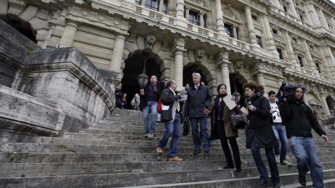 Carlo Dalla Vedova, lawyer of Amanda Knox, third from left, talks to journalists as he leaves Italy's Court of Cassation, in Rome, Tuesday, March 26, 2013. Italy's highest criminal court has overturned the acquittal of Amanda Knox in the slaying of her British roommate and ordered a new trial. The Court of Cassation ruled Tuesday that an appeals court in Florence must re-hear the case against the American and her Italian-ex-boyfriend for the murder of 21-year-old Meredith Kercher. (AP Photo/Gregorio Borgia)