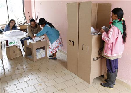 A woman prepares to vote during a congressional election in Toribio in Cauca province