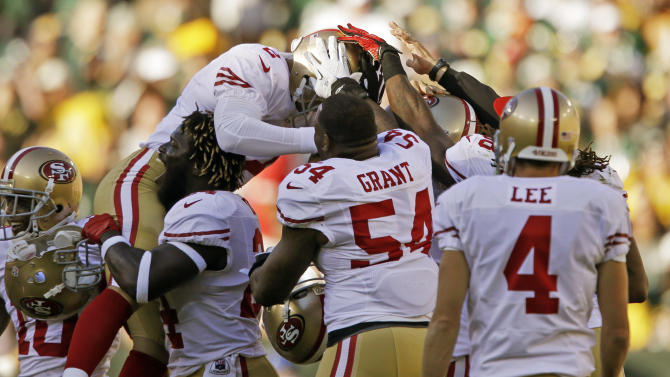 San Francisco 49ers kicker David Akers is congratulated by teammates after kicking a 63-yard field goal during the first half of an NFL football game against the Green Bay Packers Sunday, Sept. 9, 2012, in Green Bay, Wis. Akers tied an NFL record with the 63-yard field goal.(AP Photo/Jeffrey Phelps)
