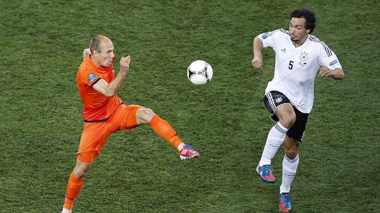 Arjen Robben of the Netherlands, left, and Germany's Mats Hummels challenge for the ball during the Euro 2012 soccer championship Group B match between the Netherlands and Germany in Kharkiv, Ukraine, Wednesday, June 13, 2012. (AP Photo/Vadim Ghirda)