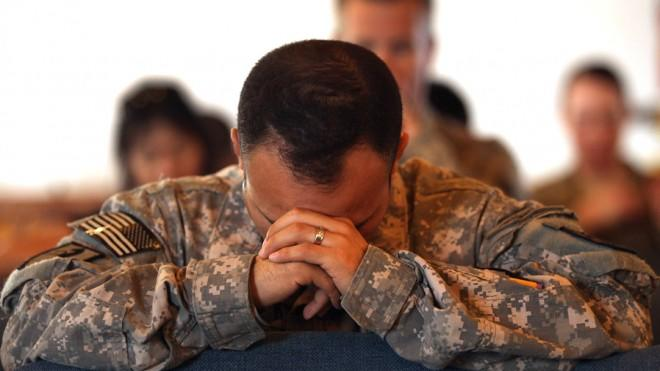 U.S. Army soldiers pray during a Catholic service in 2011.