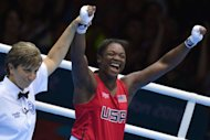 Claressa Shields of the USA celebrates defeating Nadezda Torlopova of Russia to win gold during the women's boxing Middleweight of the 2012 London Olympic Games at the ExCel Arena in London