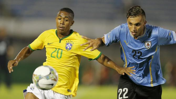 Brazil's Malcom challenges Uruguay's Mathias Suarez during their South American Under-20 Championship final round soccer match in Montevideo