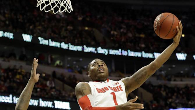 Ohio State's Deshaun Thomas goes up for a shot against Michigan State's Derrick Nix (25) during the first half of an NCAA college basketball game e at the Big Ten tournament Saturday, March 16, 2013, in Chicago. (AP Photo/Nam Y. Huh)