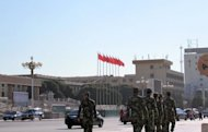 Chinese security forces patrol Xinjiang in 2011. Twenty people died when a group armed with knives attacked a market in Xinjiang, the latest outbreak of violence in the ethnically divided Chinese region, authorities said