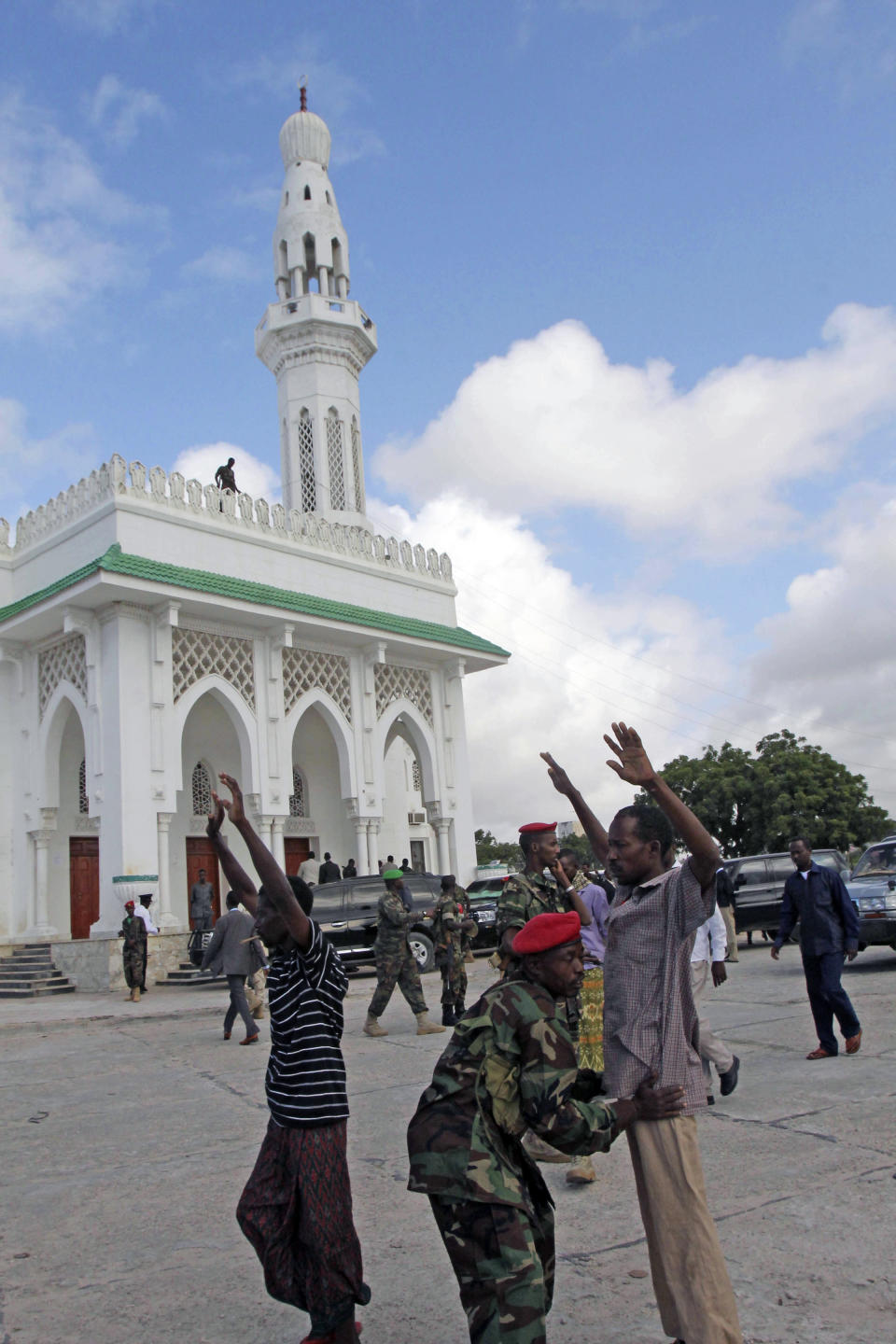 Somali government soldier checking people entering Isbahaysi Mosque in Mogadishu,Somalia  during Eid al Fitr prayers Sunday Aug, 19, 2012.(AP Photo/Farah Abdi Warsameh)