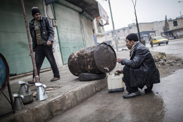 People sell fuel in the streets of Aleppo, Syria, Saturday, Jan. 5, 2013. The revolt against President Bashar Assad that started in March 2011 began with peaceful protests but morphed into a civil war