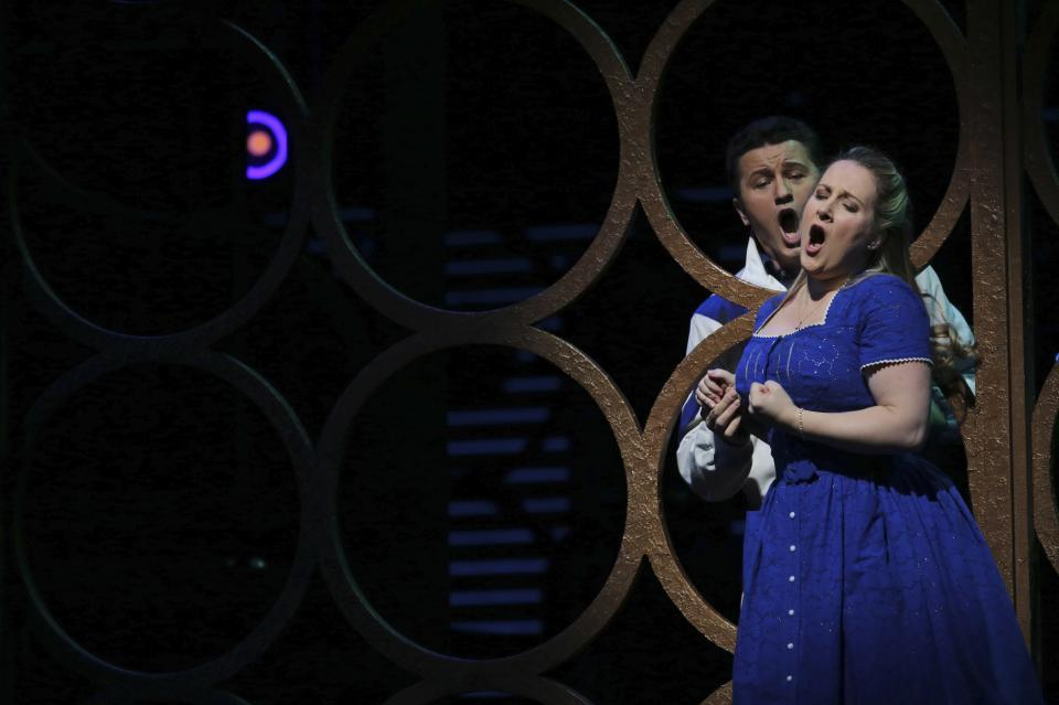 In this Friday, Jan. 25 2013 photo, Piotr Beczala, left, performs as The Duke alongside Diana Damrau performing as Gilda during the final dress rehearsal of Giuseppe Verdi's Rigoletto at the Metropolitan Opera in New York.  (AP Photo/Mary Altaffer)