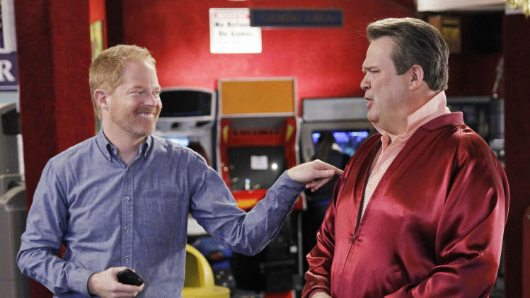 "This TV publicity image released by ABC shows Eric Stonestreet, as Cameron, right, and Jesse Tyler Ferguson as Mitchell in a scene from the comedy ""Modern Family.""  The ACLU is lobbying for the gay couple on ""Modern Family"" to get married. ACLU Action started a campaign to urge the show's producers to script a wedding episode for Mitchell and Cameron, already fathers of an adopted child and one of three couples at the heart of the show. (AP Photo/ABC, Peter ""Hopper"" Stone)"