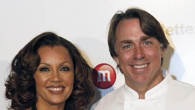 """IMAGE DISTRIBUTED FOR MARS CHOCOLATE NORTH AMERICA - Vanessa Williams, voice of the sixth M&M'S character, Ms. Brown, and New Orleans chef John Besh seen at the """"Better With M"""" Kick-Off Event on Thursday, Jan. 31, 2013 in New Orleans. The event featured a three-course chocolate-fueled dinning experience created by John Besh, and a rare, live performance from multi-award winning performer Vanessa Williams. (Jonathan Bachman / AP Images for Mars Chocolate North America)"""