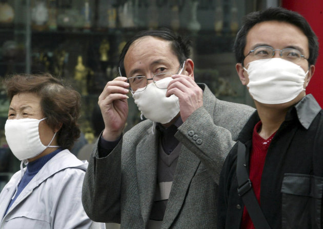 <p>               FILE - In this Monday, April 21, 2003 file photo, a Chinese man wearing a mask removes his glasses while walking with others in downtown Beijing, China. A genetic variant commonly found in Chinese people may help explain why some patients got seriously ill with swine flu, a discovery scientists say could help pinpoint why flu viruses hit some populations particularly hard and change how they're treated. Less than one percent of Caucasians are thought to have the gene alteration, which has previously been linked to severe influenza. About 25 percent of Chinese have the gene variant, which is also common in Japanese and Korean people. (AP Photo/Ng Han Guan, File)