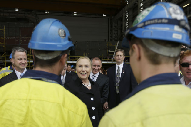 U.S. Secretary of State Hillary Rodham Clinton, center, meets with shipbuilders at the Techport Australia shipbuilding facility near Adelaide, Australia Thursday, Nov. 15, 2012. (AP Photo/Matt Rourke, Pool)