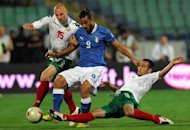 Italy's Pablo Osvaldo (C) clashes with Bulgaria's Ivan Ivanov (L) and Ivelin Popov during their World Cup 2014 qualification football match at Vassil Levski stadium in Sofia. The match ended in a 2-2 draw