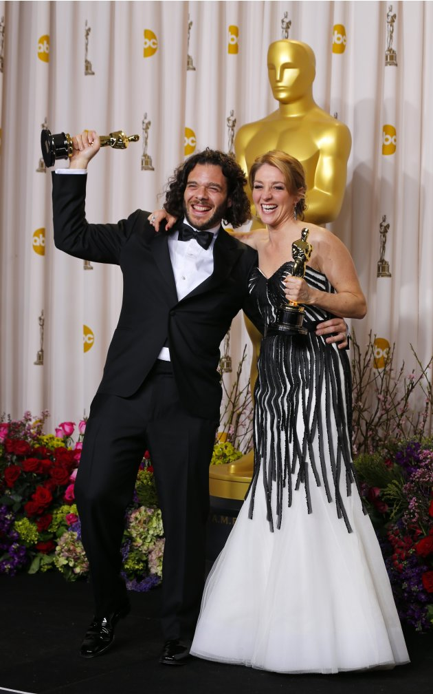 "Sean Fine and Andrea Nix Fine pose after winning Best Documentary Short Subject for their film ""Inocente"" at the 85th Academy Awards in Hollywood"