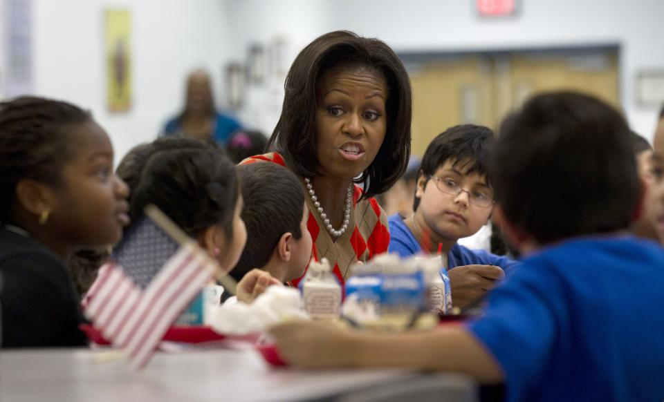 First lady Michelle Obama has lunch with school children at Parklawn elementary school in Alexandria, Va., Wednesday,Jan., 25, 2012. (AP Photo/Pablo Martinez Monsivais)