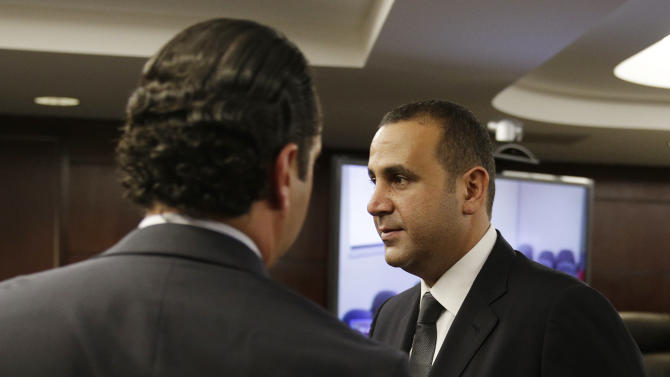Sam Nazarian leaves a meeting of the Nevada Gaming Commission Thursday, Dec. 18, 2014, in Las Vegas. Nazarian, a 10 percent owner of the SLS Las Vegas hotel and casino, appeared before the commission seeking a gaming license. (AP Photo/John Locher)