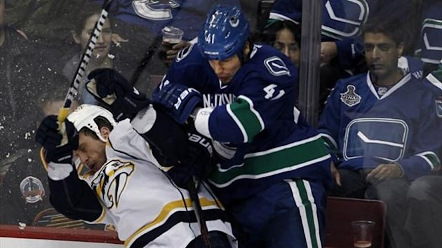 Vancouver Canucks' Andrew Alberts (R) crashes into Nashville Predators' Rich Clune (Reuters)