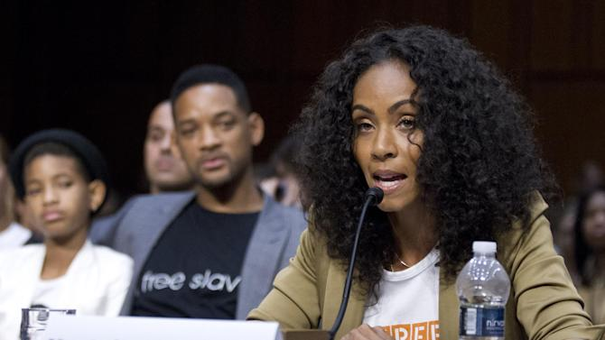 """Jada Pinkett Smith, right, accompanied by her actor husband Will Smith, and their daughter Willow Camille Reign Smith, left, testifies before the Senate Foreign Relations Committee during a hearing on """"The Next Ten Years in the Fight Against Human Trafficking: Attacking the Problem with the Right Tools"""" on Capitol Hill in Washington Tuesday, July 17, 2012.  (AP Photo/Manuel Balce Ceneta)"""