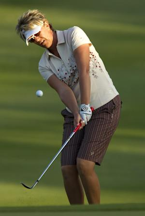 Beth Bader chips onto the ninth green in the first round of the LPGA Lotte Championship golf tournament at  Ko Olina Golf Club on Wednesday, April 18, 2012, in Kapolei, Hawaii. (AP Photo/Eugene Tanner)