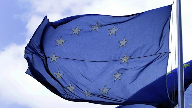 "FILE - In this Tuesday May 4, 2010 file photo an EU flag blows in the wind outside a meeting of EU transport ministers at the EU Council building in Brussels.  The European Union was awarded on Friday Oct. 12, 2012 the Nobel Peace Prize for its efforts to promote peace and democracy in Europe, in the midst of the union's biggest crisis since its creation in the 1950s. The Norwegian prize committee said the EU received the award for six decades of contributions ""to the advancement of peace and reconciliation, democracy and human rights in Europe. (AP Photo/Virginia Mayo, File)"