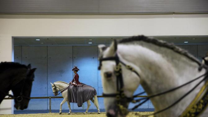 Riders from the Francisco Canales equestrian group practice before performing during Madrid Horse Week in Madrid
