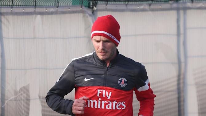 David Beckham runs in the  sand during a practice session with Paris Saint-Germain soccer team in Saint-Germain-en-Laye, west of Paris, Wednesday, Feb. 13, 2013. David Beckham started his first practice session with Paris Saint-Germain on Wednesday amid a media frenzy as dozens of camera crews and photographers jostled for position at the club's training ground in the western suburbs of Paris. (AP Photo/Michel Euler)