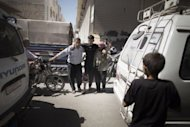 A wounded Syrian man (C) is taken to hospital after surviving an air raid by regime forces in Al-Bab, 35 kms (20 miles) northeast of Syria's commercial capital Aleppo