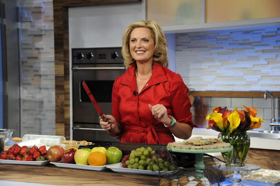 "This image released by ABC shows Ann Romney, wife of Republican presidential hopeful Mitt Romney during a cooking segment on ""Good Morning America,"" Wednesday, Oct. 10, 2012 in New York. Romney served as a guest co-host on the popular morning show. (AP Photo/ABC, Ida Mae Astute)"