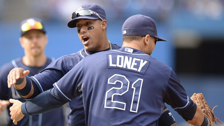 Rays hold off Toronto 7-6, clinch AL wild-card tie