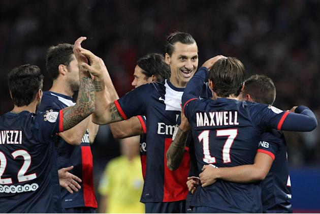 Paris Saint Germain's forward Zlatan Ibrahimovic from Sweden, center, celebrates with teammates, after he scores a goal, during his French League One soccer match against Monaco, at the Parc des Princ