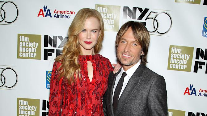"""This image released by Starpix shows actress and honoree Nicole Kidman, left, and her husband Keith Urban at a gala by The Film Society of Lincoln Center following by the premiere of  her film, """"The Paperboy"""" at the 2012 New York Film Festival at Alice Tully Hall, Wednesday, Oct. 3, 2012 in New York. (AP Photo/Starpix, Marion Curtis)"""