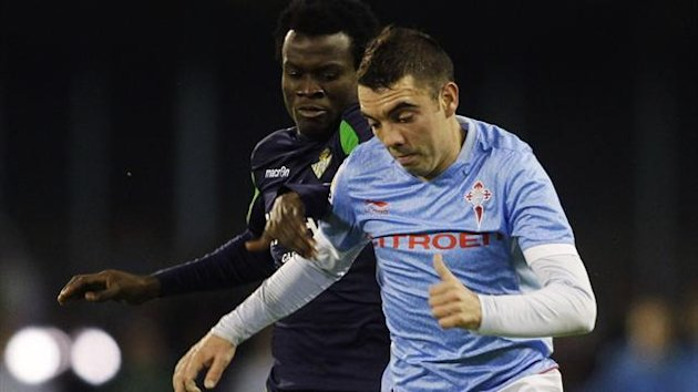 DATE IMPORTED:December 17, 2012Celta Vigo's Iago Aspas (R) battles for the ball with Real Betis' Nosa Igiebor (Reuters)