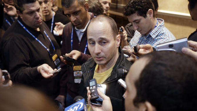 New York Yankees general manager Brian Cashman talks with reporters during the Rule 5 draft at the baseball winter meetings on Thursday, Dec. 6, 2012, in Nashville, Tenn. (AP Photo/Mark Humphrey)