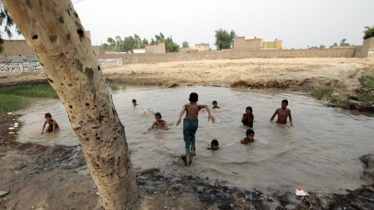 Children swim in an irrigation ditch outside Bannu in Northwest Pakistan