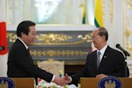 Japanese Prime Minister Yoshihiko Noda (L) and Myanmar President Thein Sein shake hands after a meeting at a summit in Tokyo. Tokyo will waive Myanmar's 300 billion yen ($3.7 billion) debt and resume suspended assistance to the country, the Japanese government said